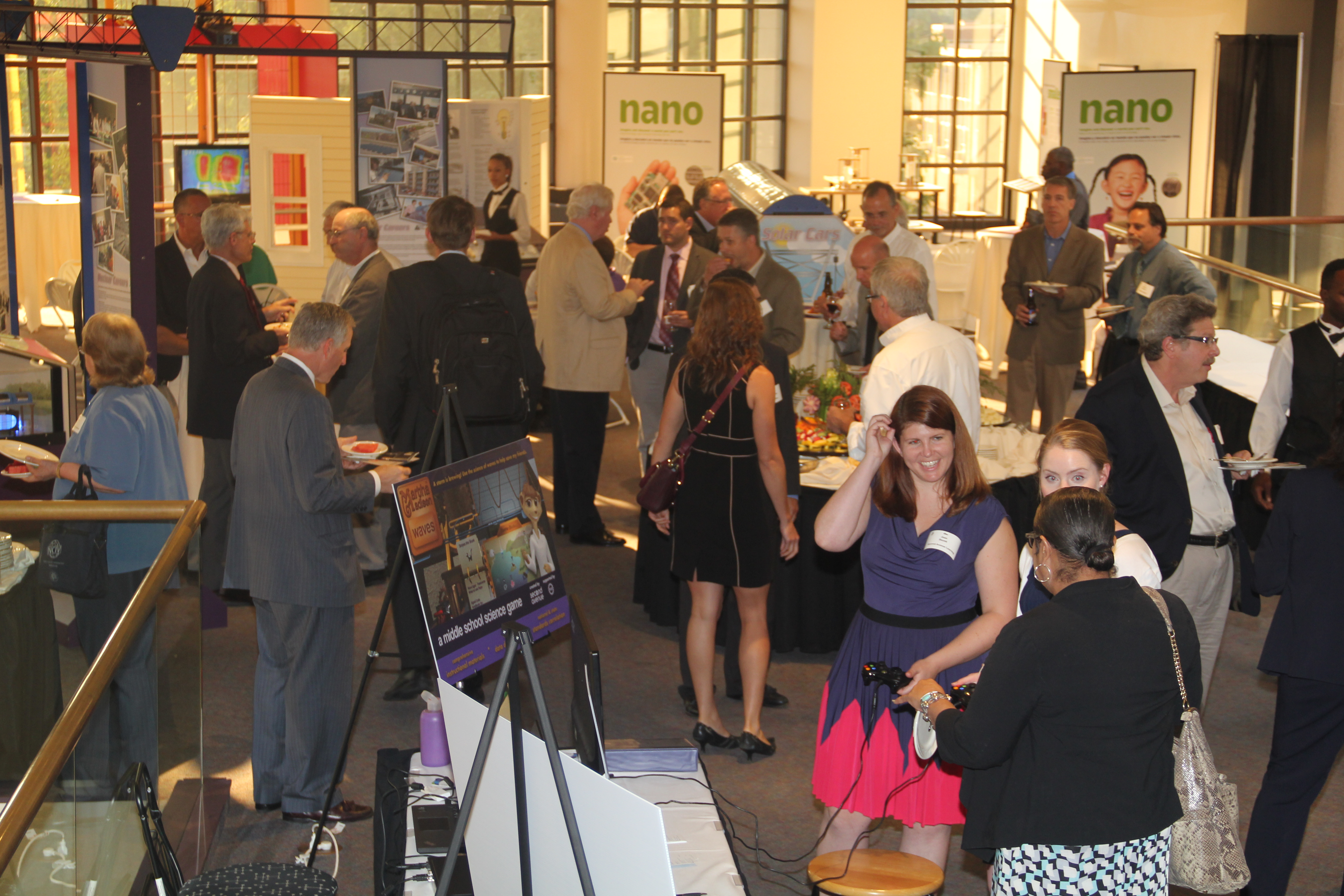 Attendees enjoy networking and refreshments after the meeting at the Rochester Museum and Science Center